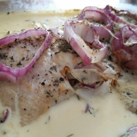 Fish Poached in Creamy White Sauce